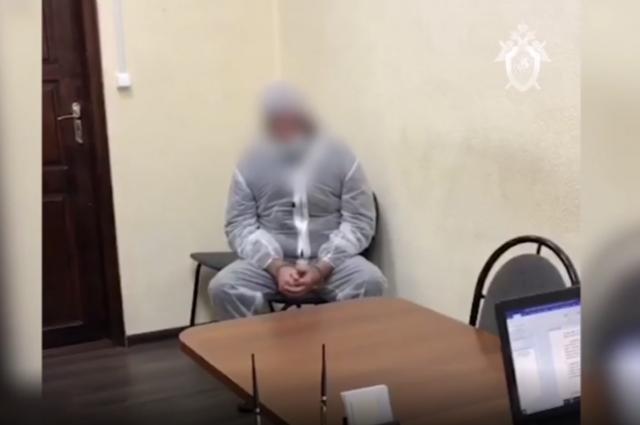 Кадр видео с допроса обвиняемого.