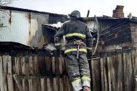 Пожар произошел в четырехквартирном жилом доме.
