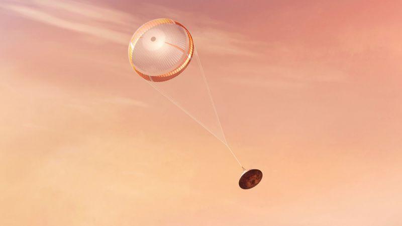 На изображении ровер раскрывает сверхзвуковой парашют, позволяющий снизить скорость перед посадкой.