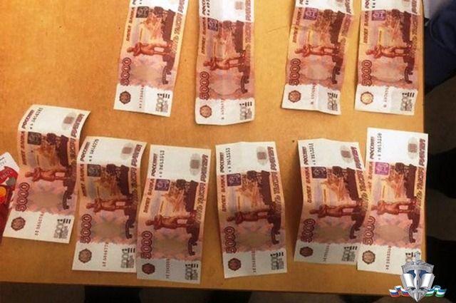 В Уфе задержали подозреваемых в сбыте фальшивых пятитысячных купюр