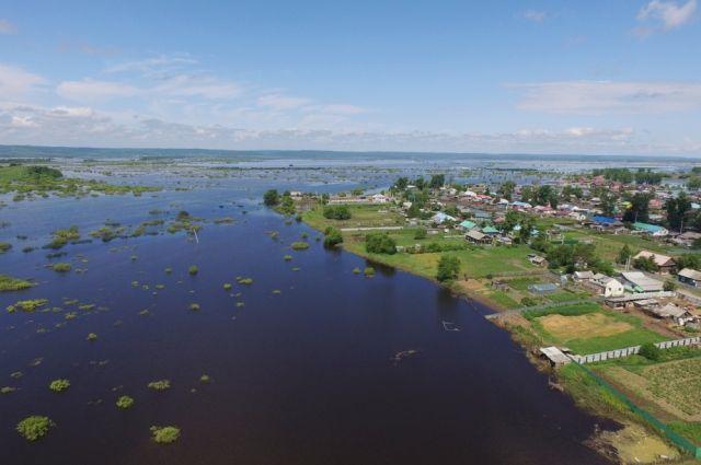Вид на подтопленную территорию села Игнатьево, в Амурской области, которая переживает мощный паводок, в регионе введен режим ЧС межрегионального характера. 30.06.2021.