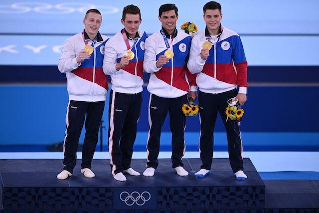 Российские спортсмены, члены сборной России (команда ОКР) Денис Аблязин, Давид Белявский, Артур Далалоян и Никита Нагорный (слева направо)