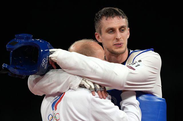 Российский спортсмен Владислав Ларин, завоевавший золотую медаль всоревнованиях потхэквондо ввесовой категории свыше 80кг среди мужчин.