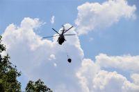 На пожар в поселке 9 Января в Оренбуржье сброшено более 200 тонн воды.